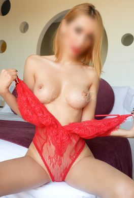 Beautiful blonde escort with a natural body