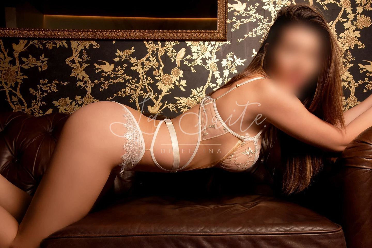 Vicky, British high end escort for GFE in Barcelona, wearing white lingerie