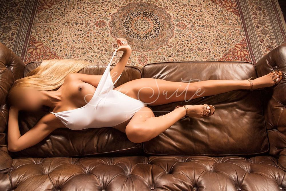 Barbara: High end Spanish escort for deep throat in Barcelona, wearing a white body