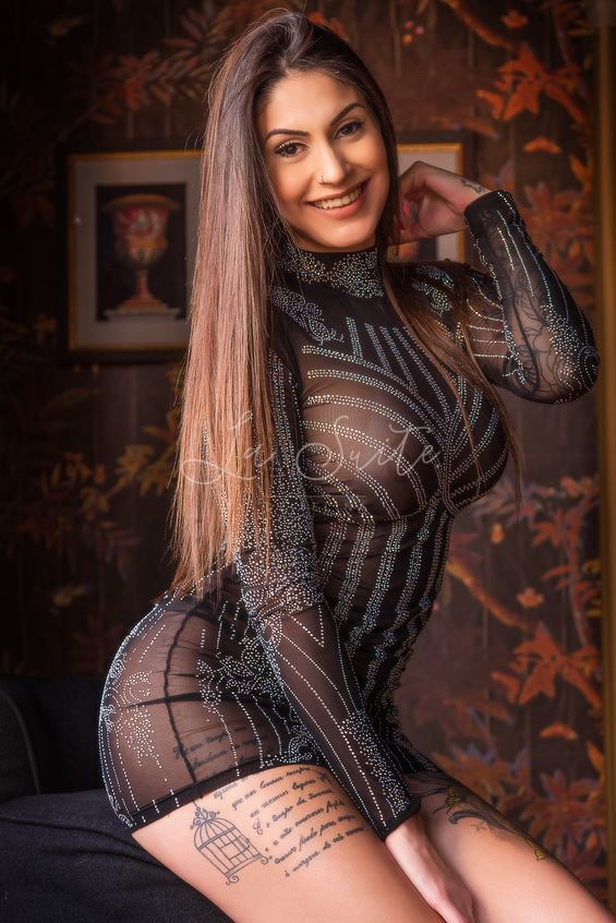 Lara: High end Brazilian escort for girlfriend experience in Barcelona, wearing a black dress