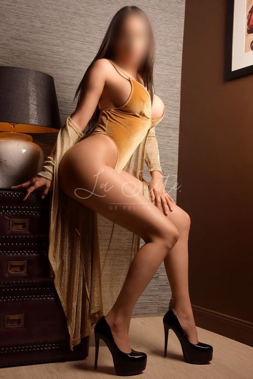 Isabella: High end Latina escort for threesome in Barcelona, wearing a yellow body