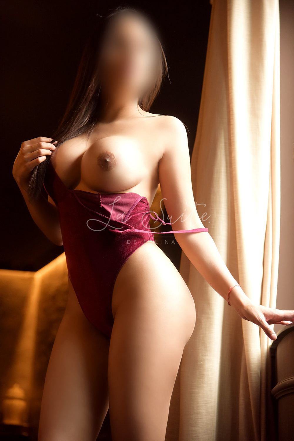 Isabella: Luxury Latina escort for fetish sex in Barcelona, wearing a red body